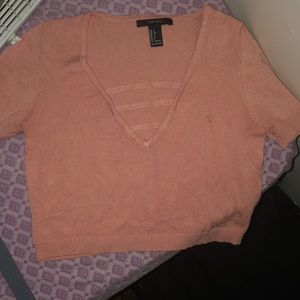 A pink cut out shirt at the top